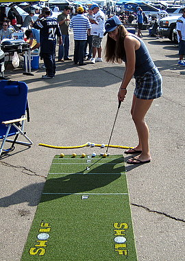Hot girl playing Sholf at a San Diego Chargers tailgate party