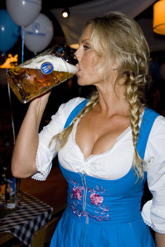 Busty girl drinking beer