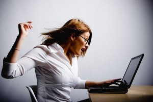 Woman angry at laptop