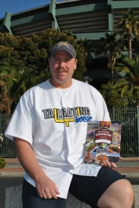Dave Lamm with Pro Football Cookbook in front of stadium