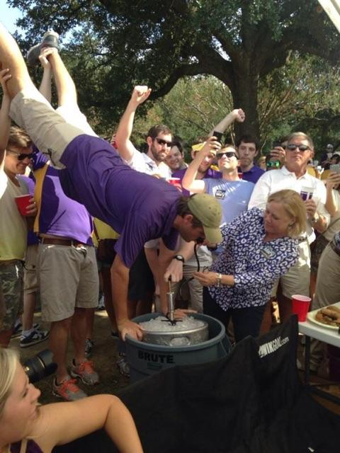 Mary Landrieu spotted at an LSU tailgate assisting a Tiger fan with a keg stand