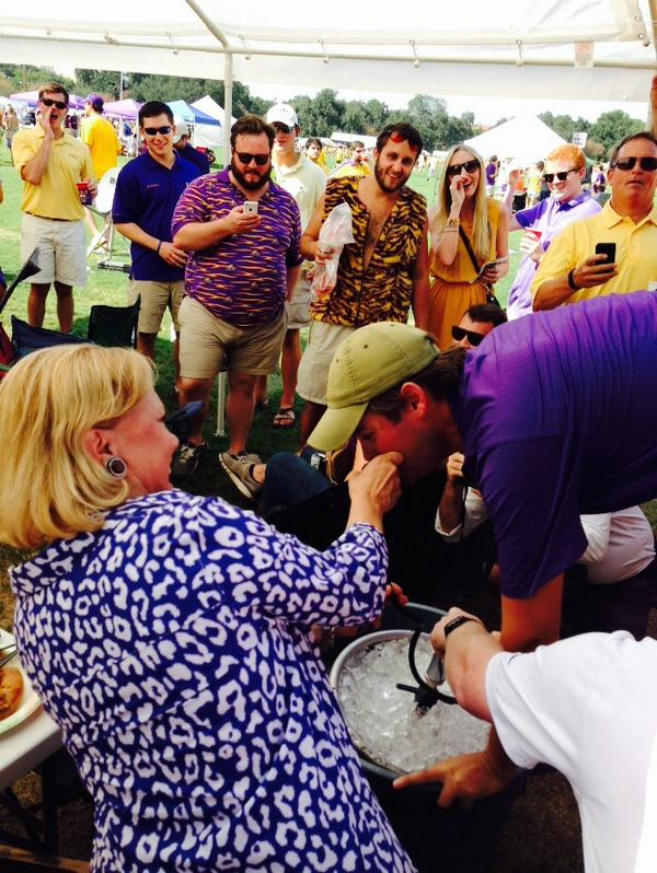 Alternative angle of Mary_Landrieu assisting with a keg stand while at LSU tailgate party.