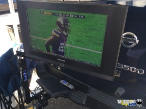 NFL Football game shown in the parking lot off of a DISH Tailgater system