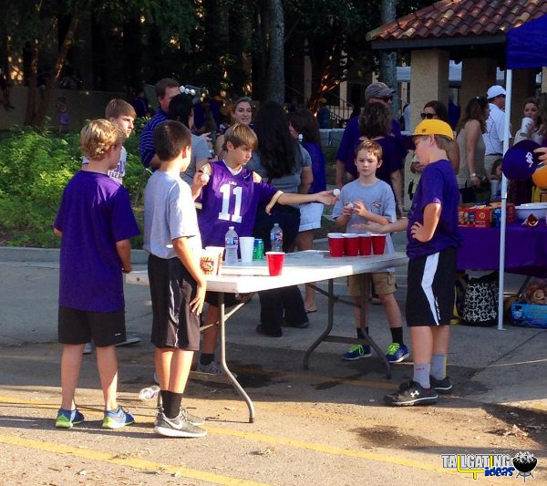 "LSU kids playing a game of ""beer pong"" while tailgating"