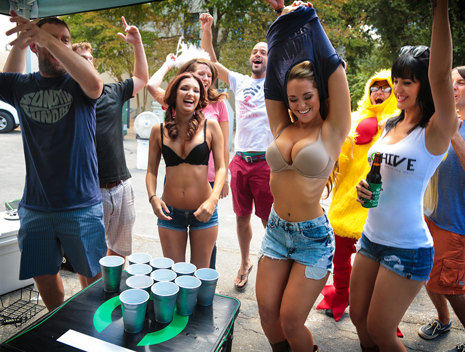Girl playing strip beer pong